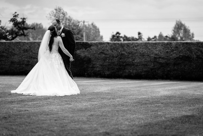 Bride kissing groom at Albright Hussey Manor