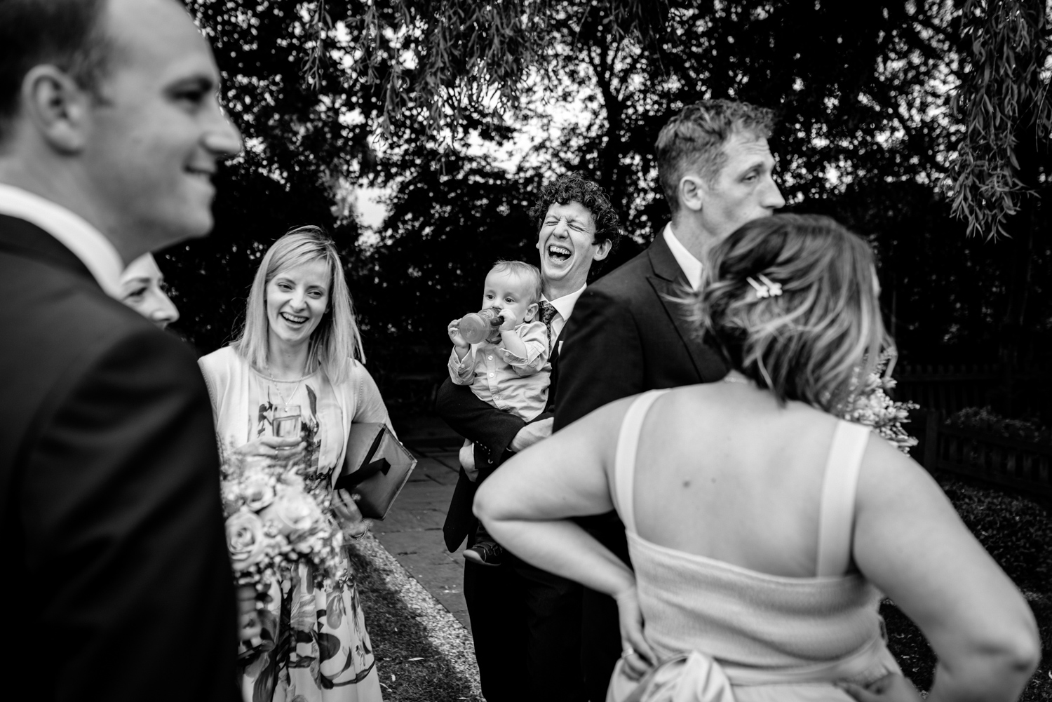Wedding guests laughing at Albright Hussey