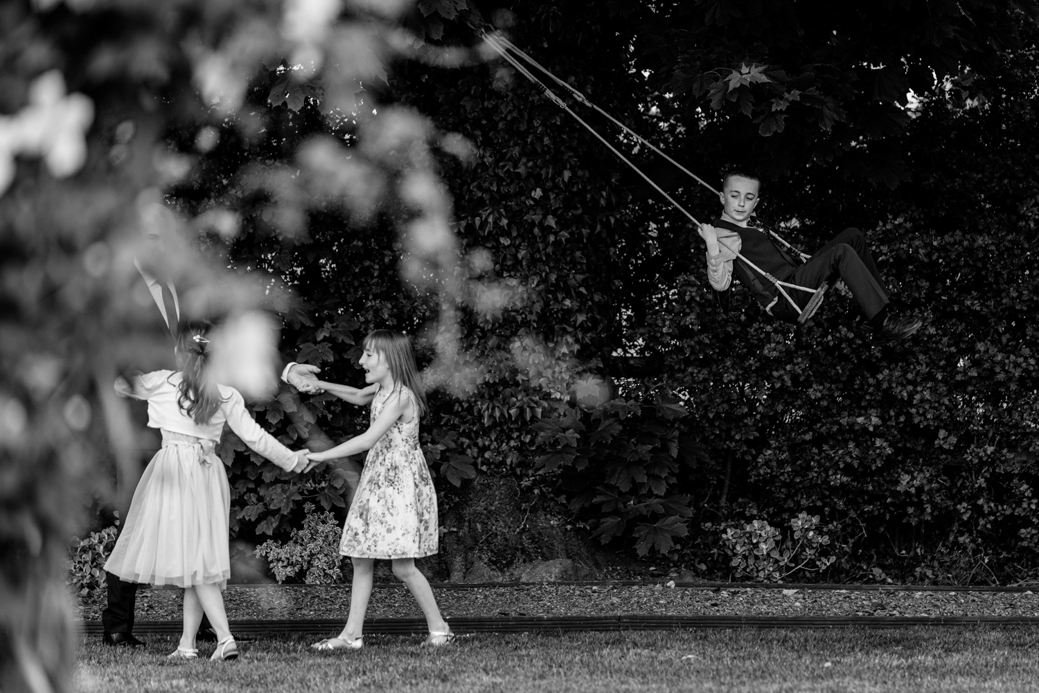 Children playing and boy on swing