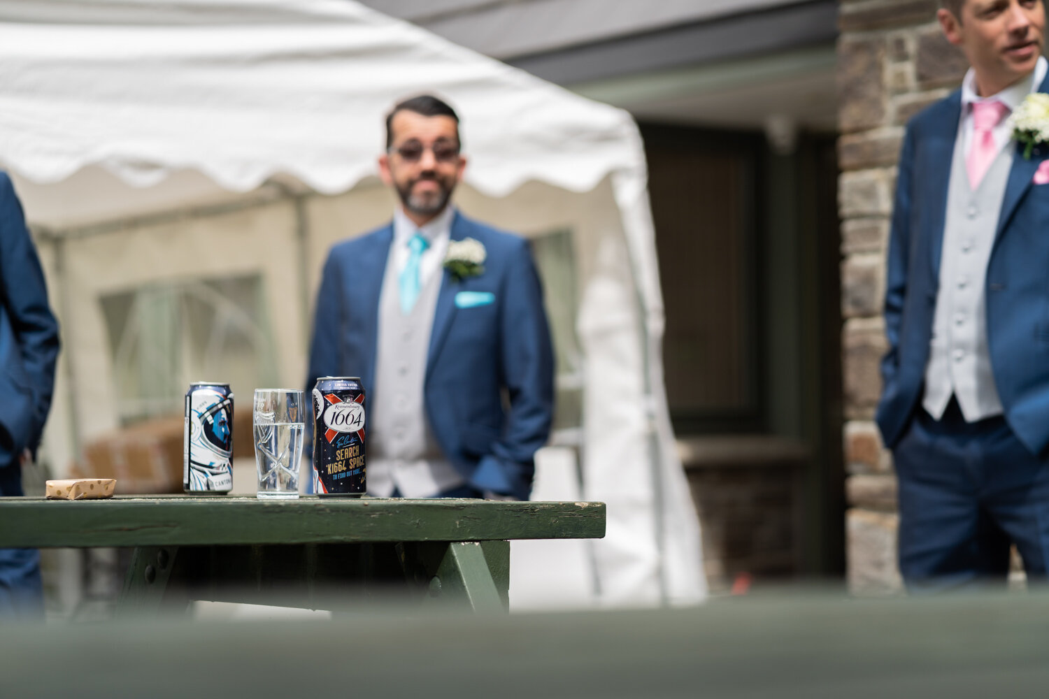 Can of beer and ushers before wedding