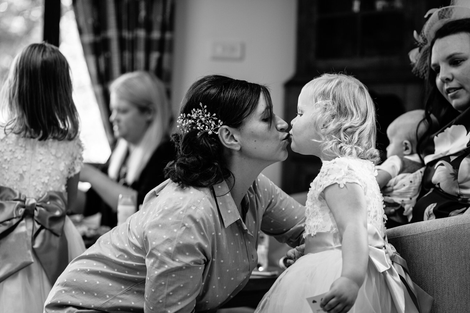 Bride and flower girl kissing