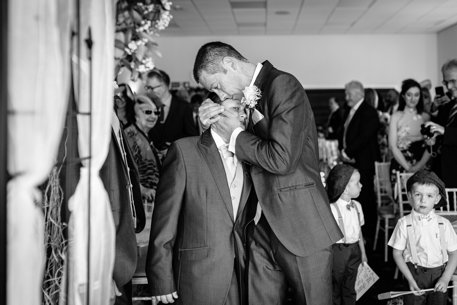Groom and brides son embrace