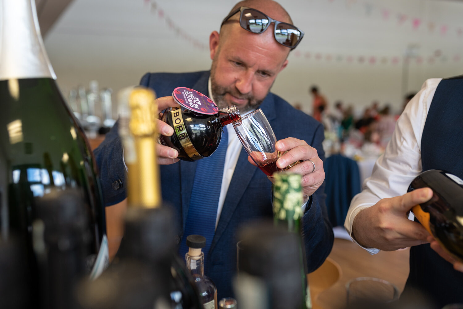 Wedding guest pouring a drink