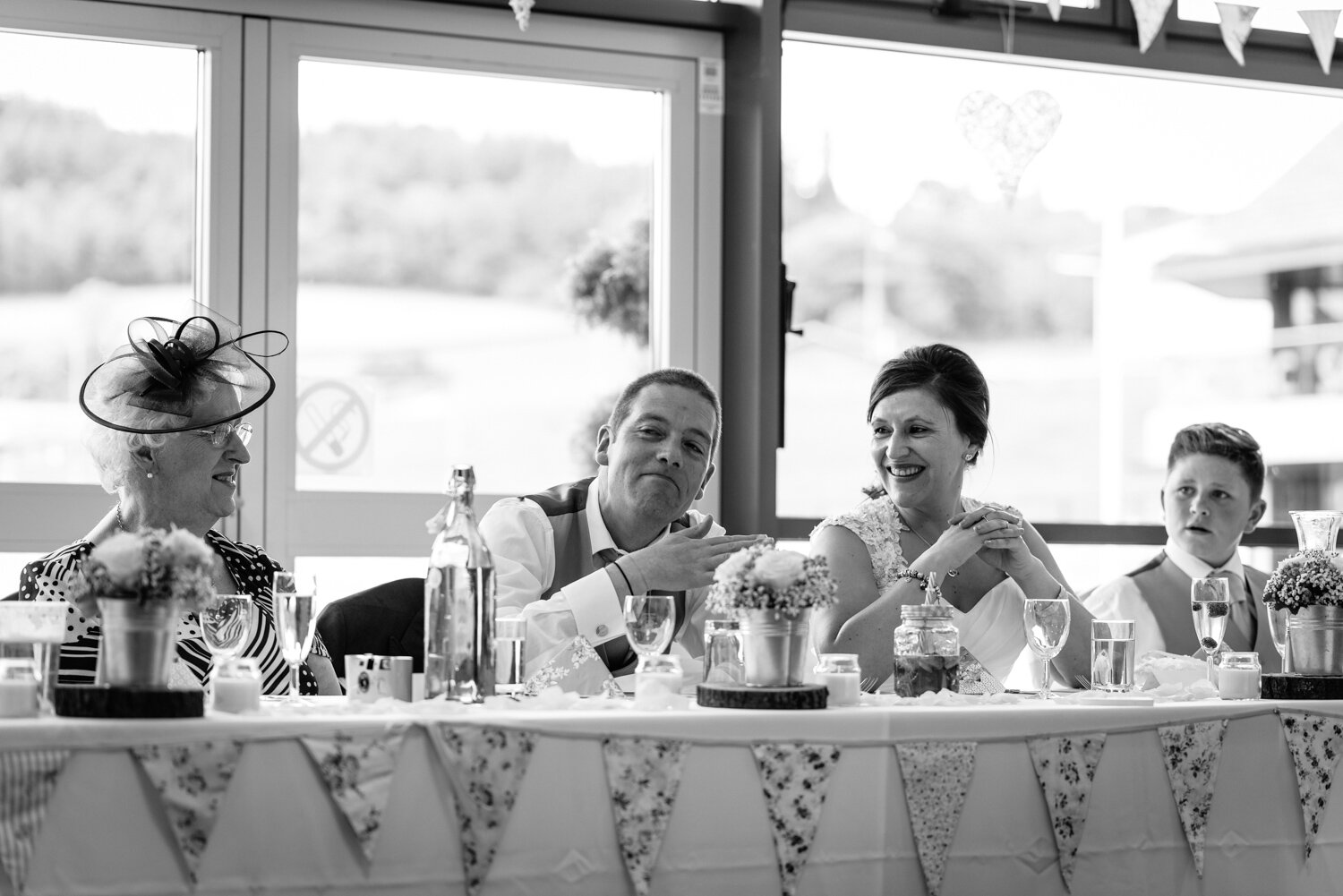Bride laughing at groom during wedding speeches