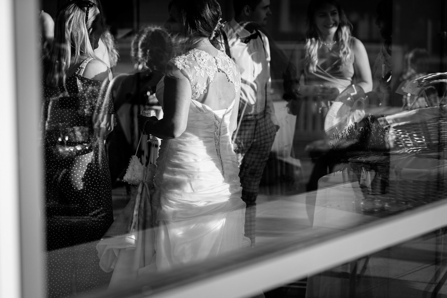Reflection of brides dress in window