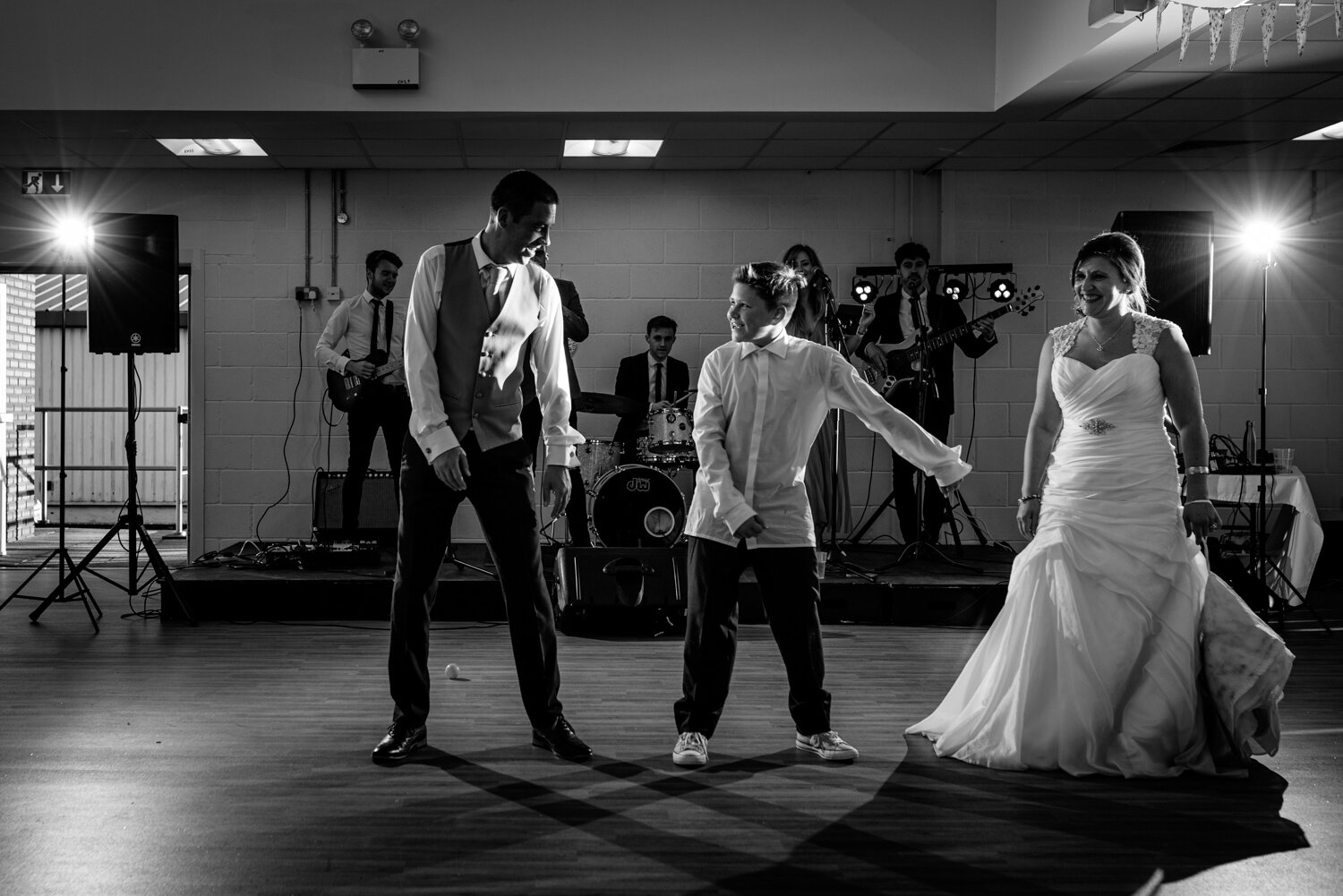 Bride, son and groom dancing