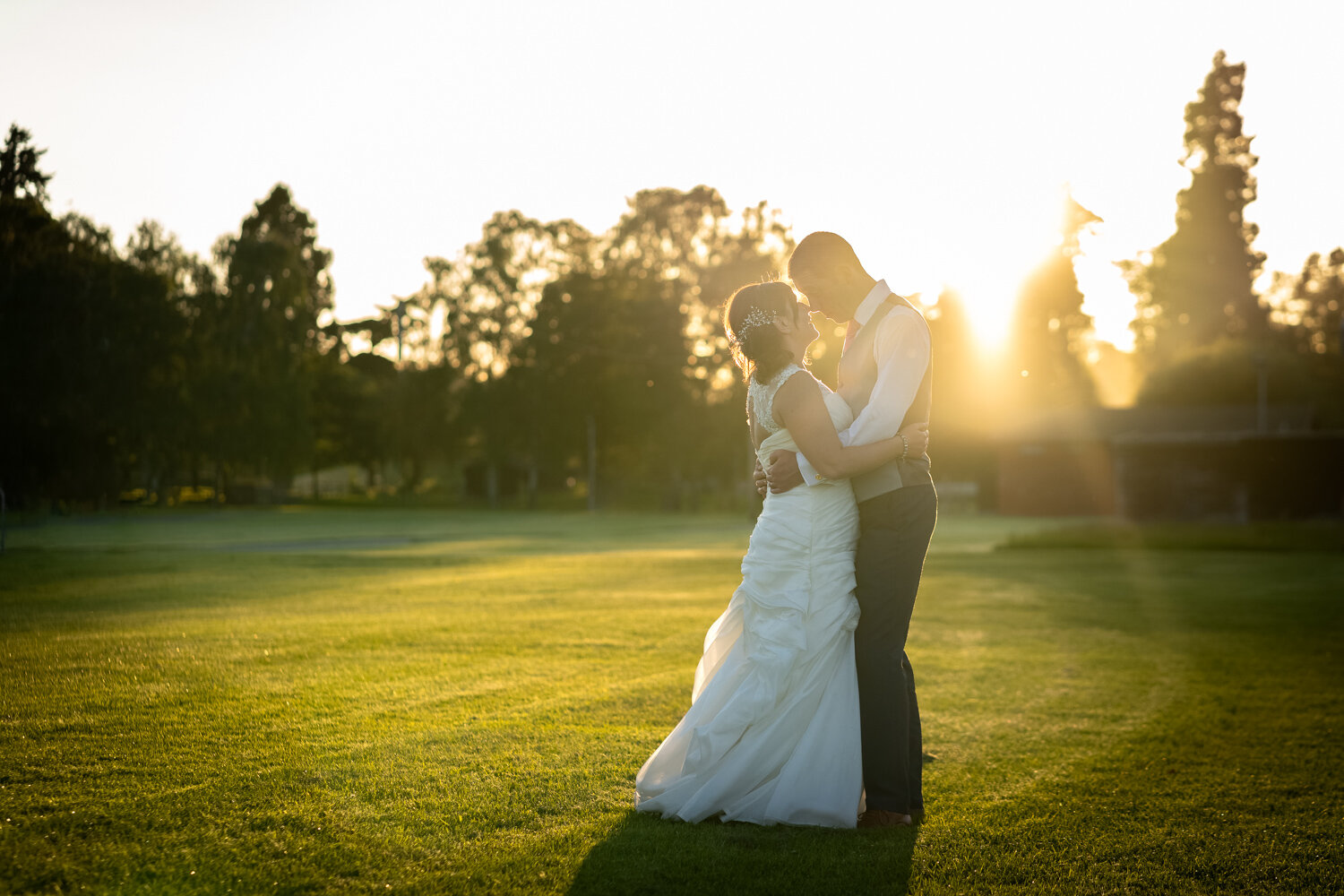 Sunset portrait of bride and groom at Royal Welsh Showground