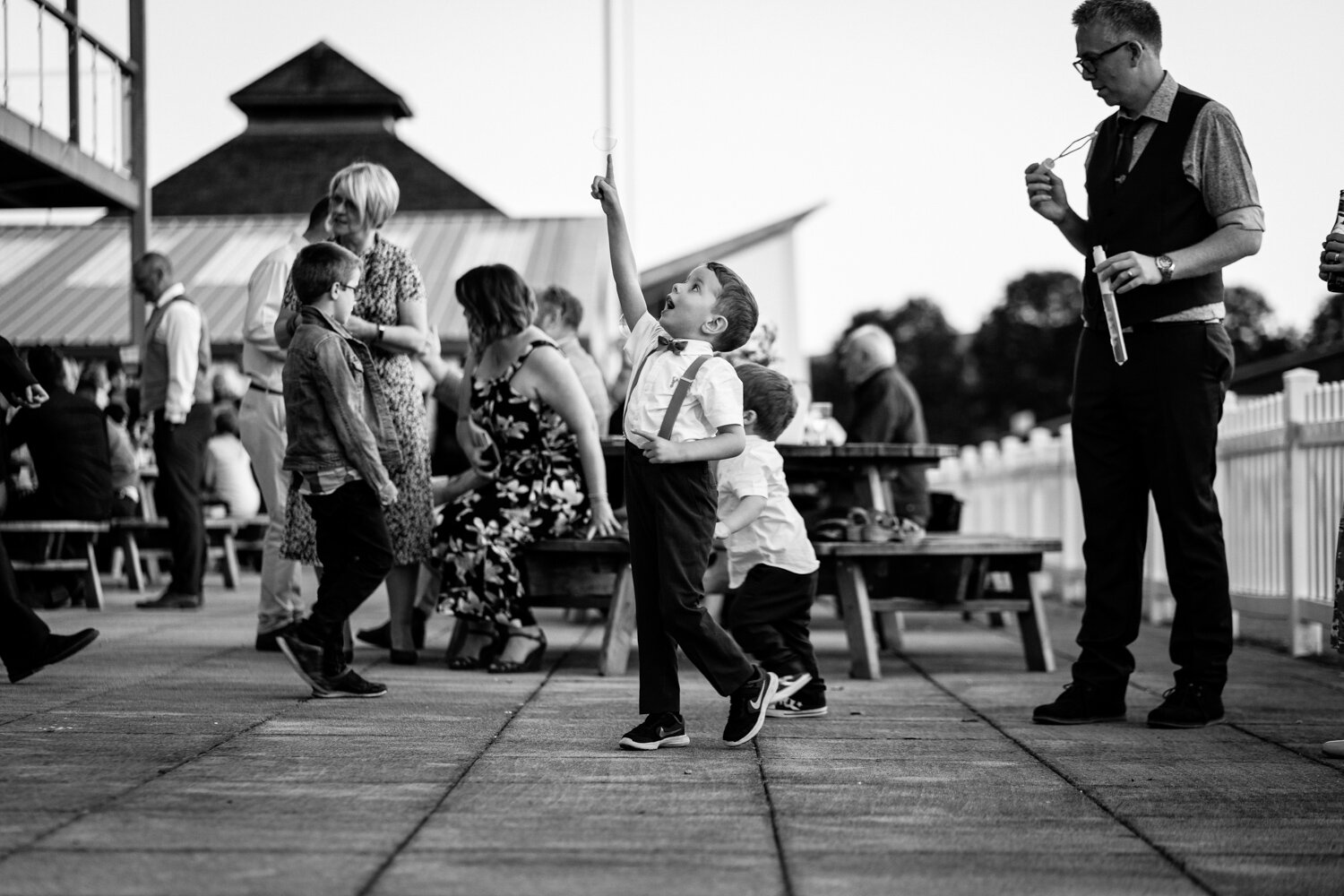 Children playing at wedding popping bubbles