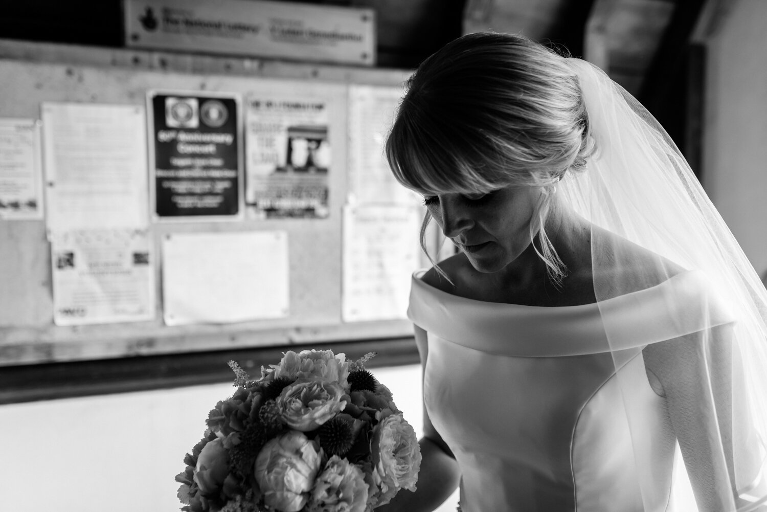Bride waiting in church doorway