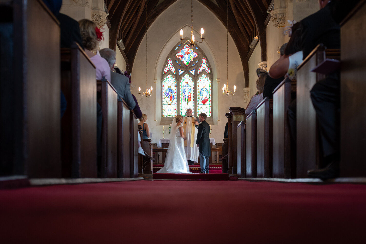 Bride and groom at altar during Powys wedding