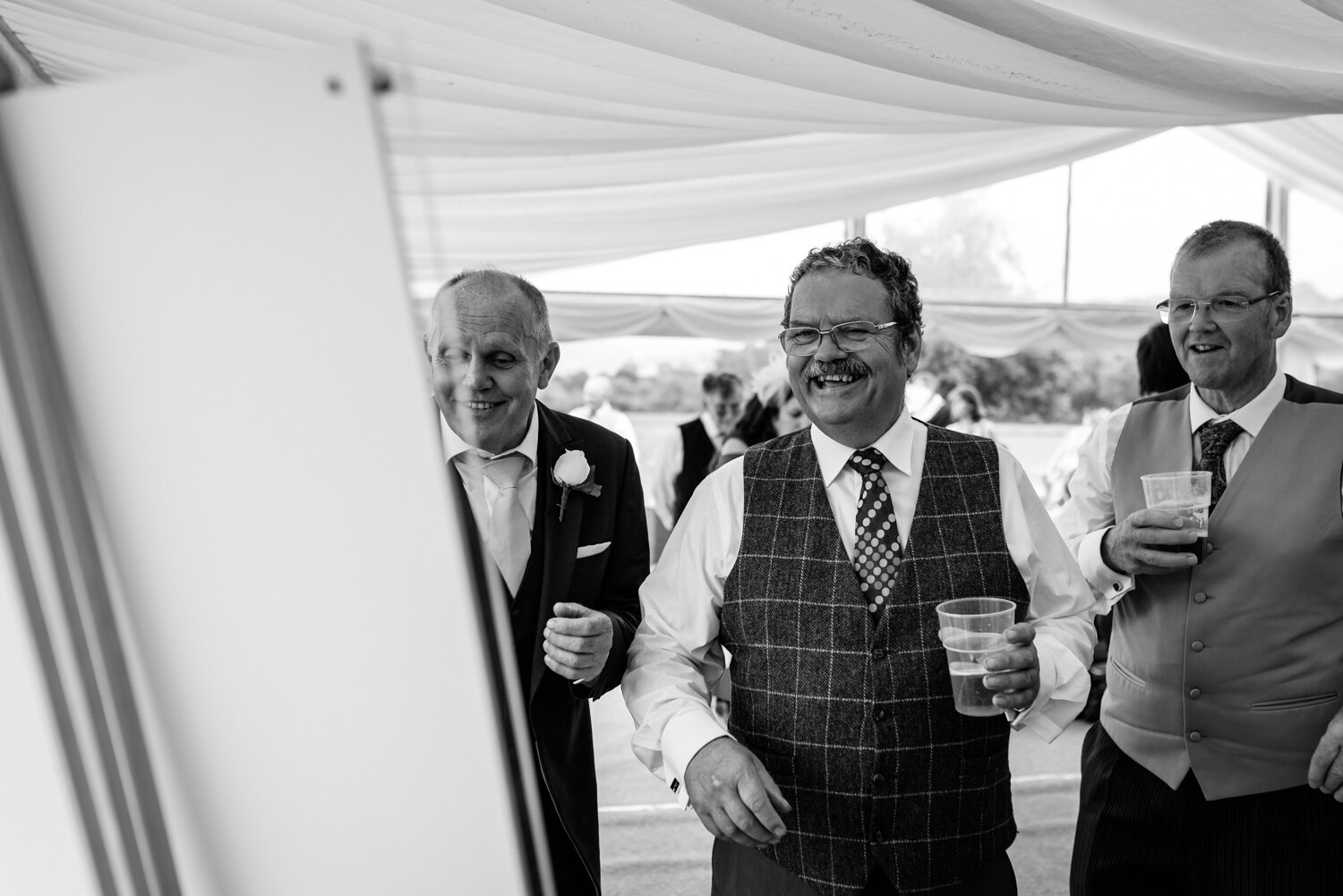 Wedding guests laughing at Powys wedding