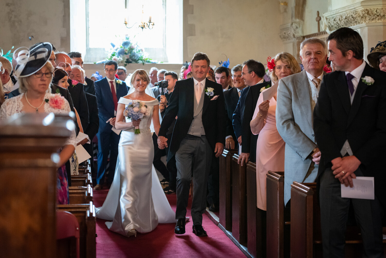 Powys wedding bride walking down aisle in Glasbury