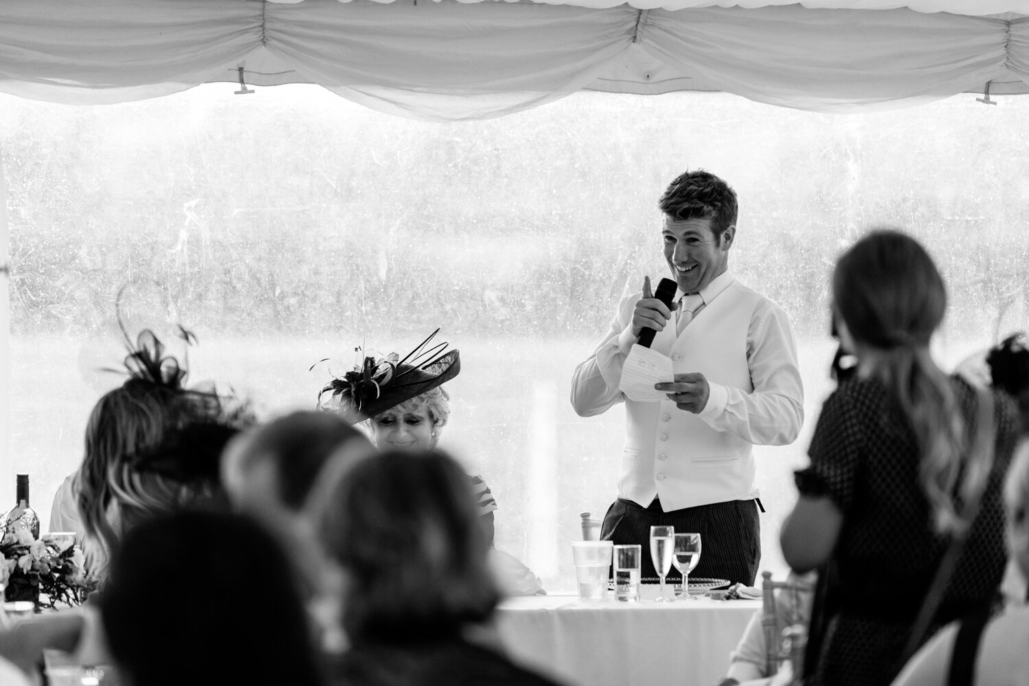 Master of ceremonies during speeches at Powys wedding