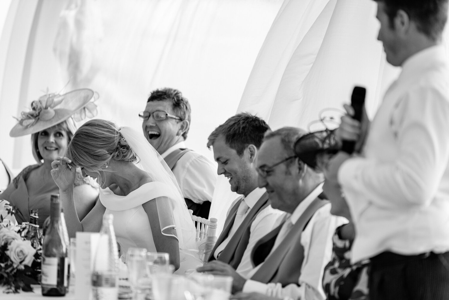 Laughter during Sam & Will's Powys wedding