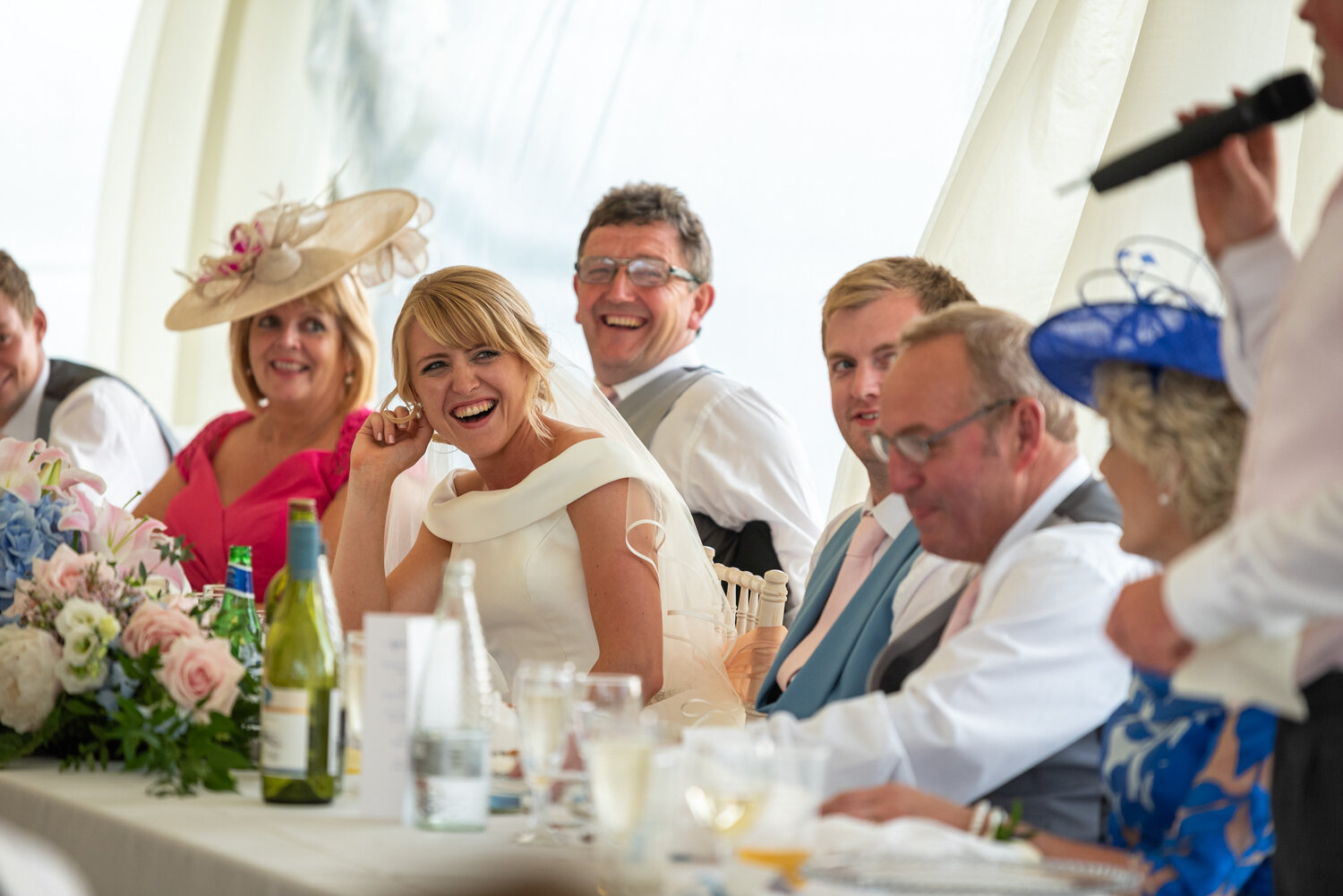 Sam laughing at speeches during her Powys wedding