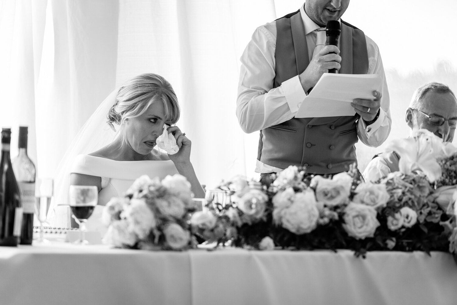 Bride with tears during grooms speech