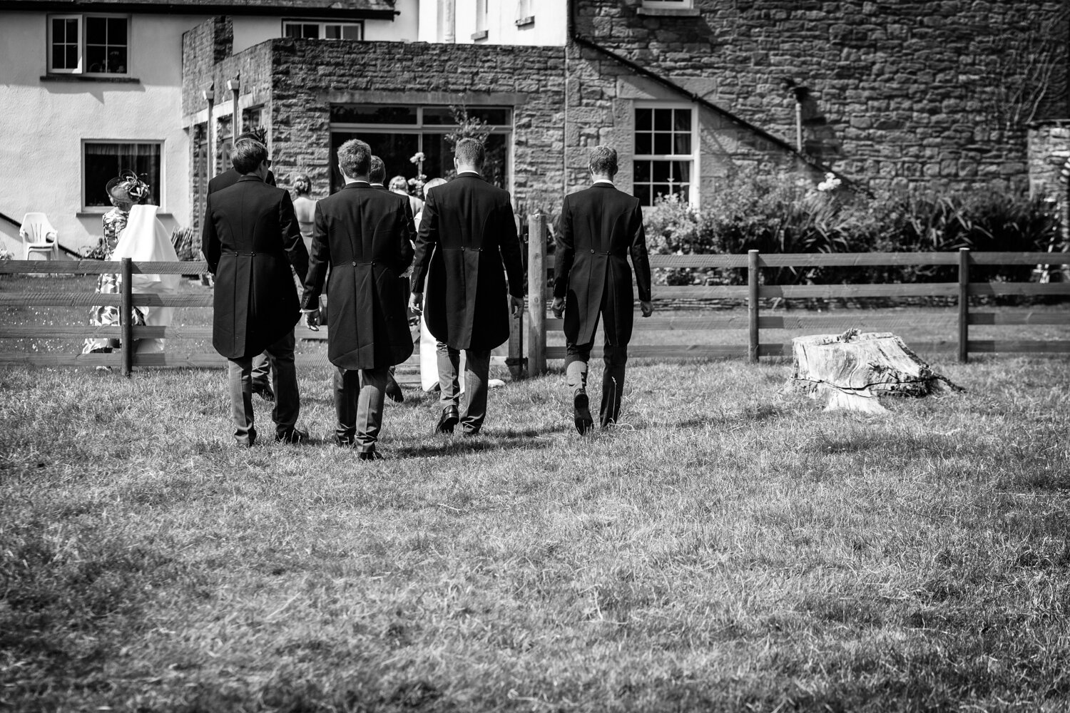 Groom and groomsmen walking away