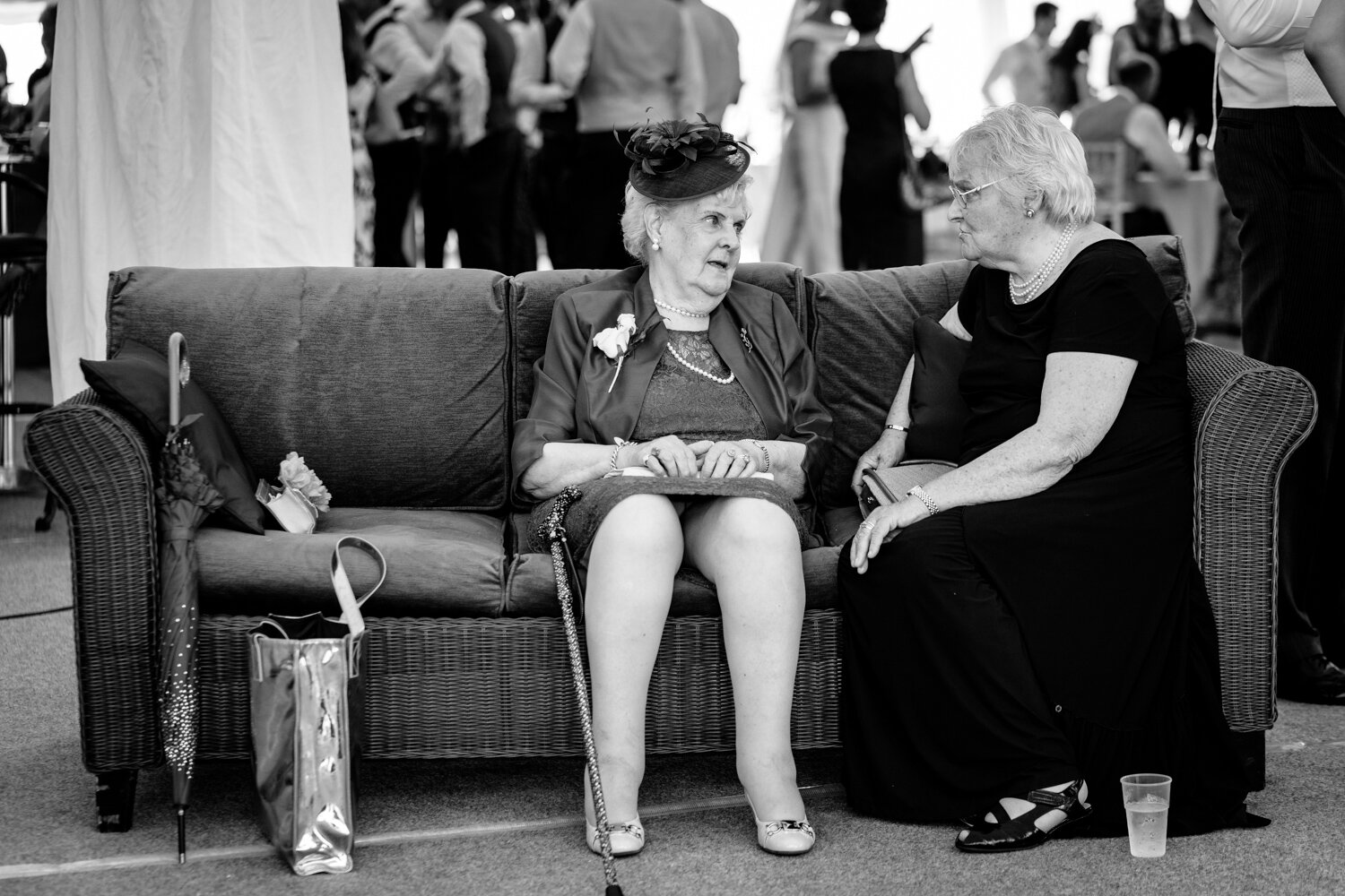Two older wedding guests talking