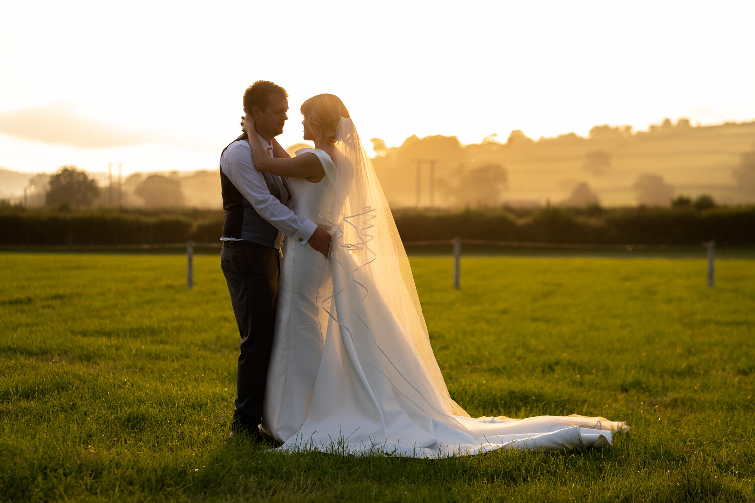 Bride and groom during golden hour at Powys wedding
