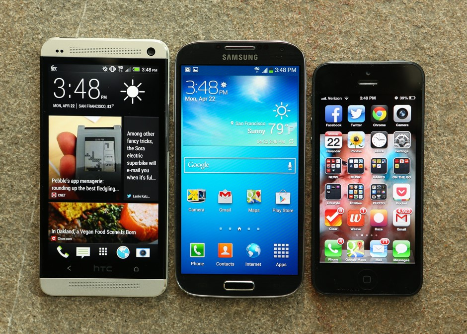 Left to right: the HTC One, Samsung Galaxy S4, and the Apple iPhone 5.   (photo courtesy of CNET.com)