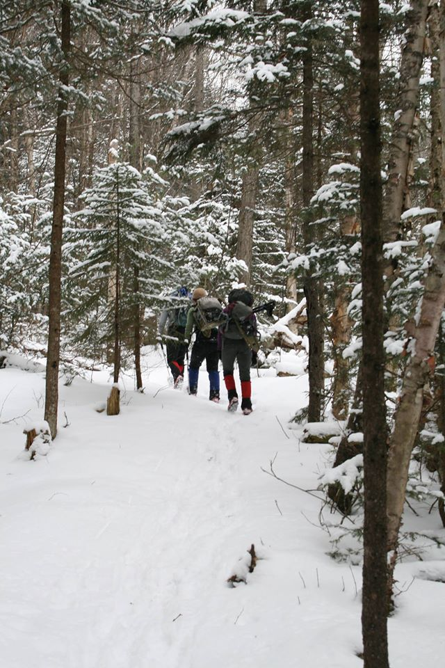 Employee hiking in the snow.
