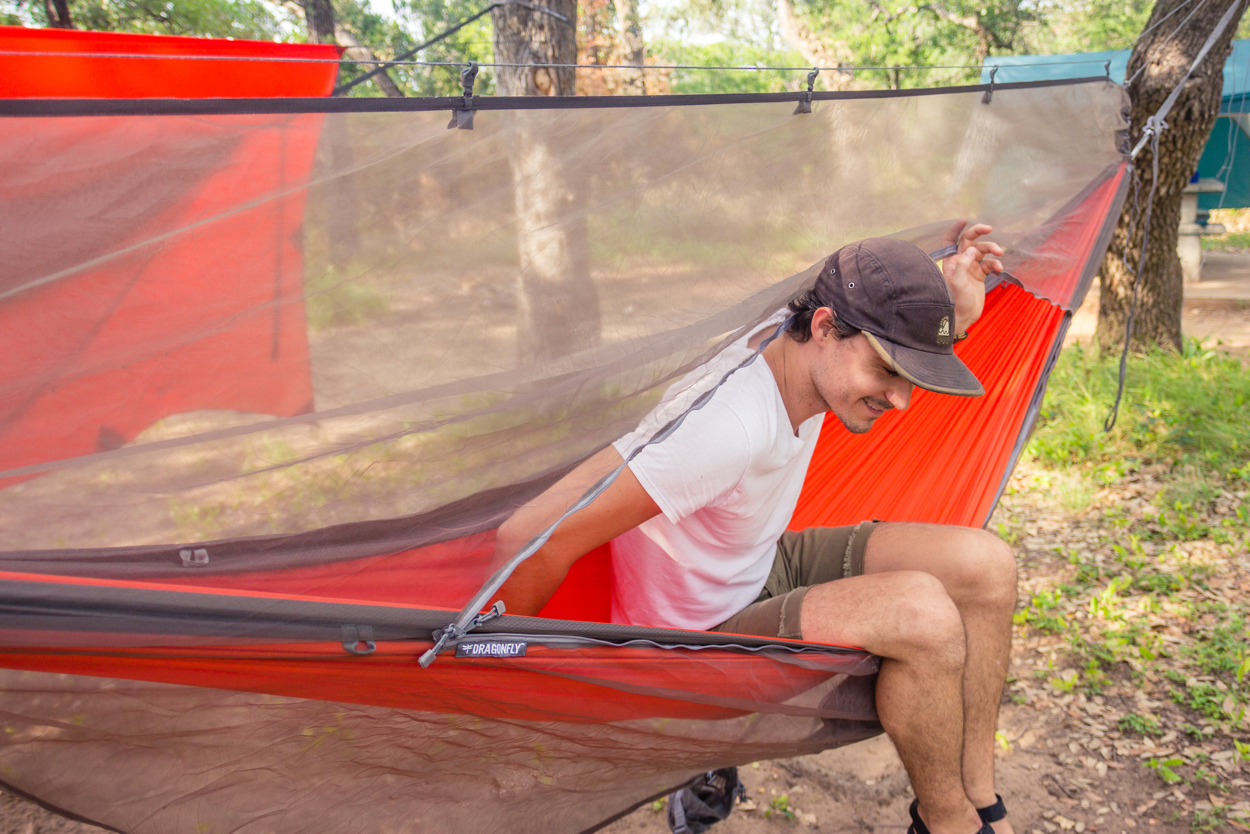 Chris trying the Dragonfly Insect Net over his Roo Hammock for the first time.