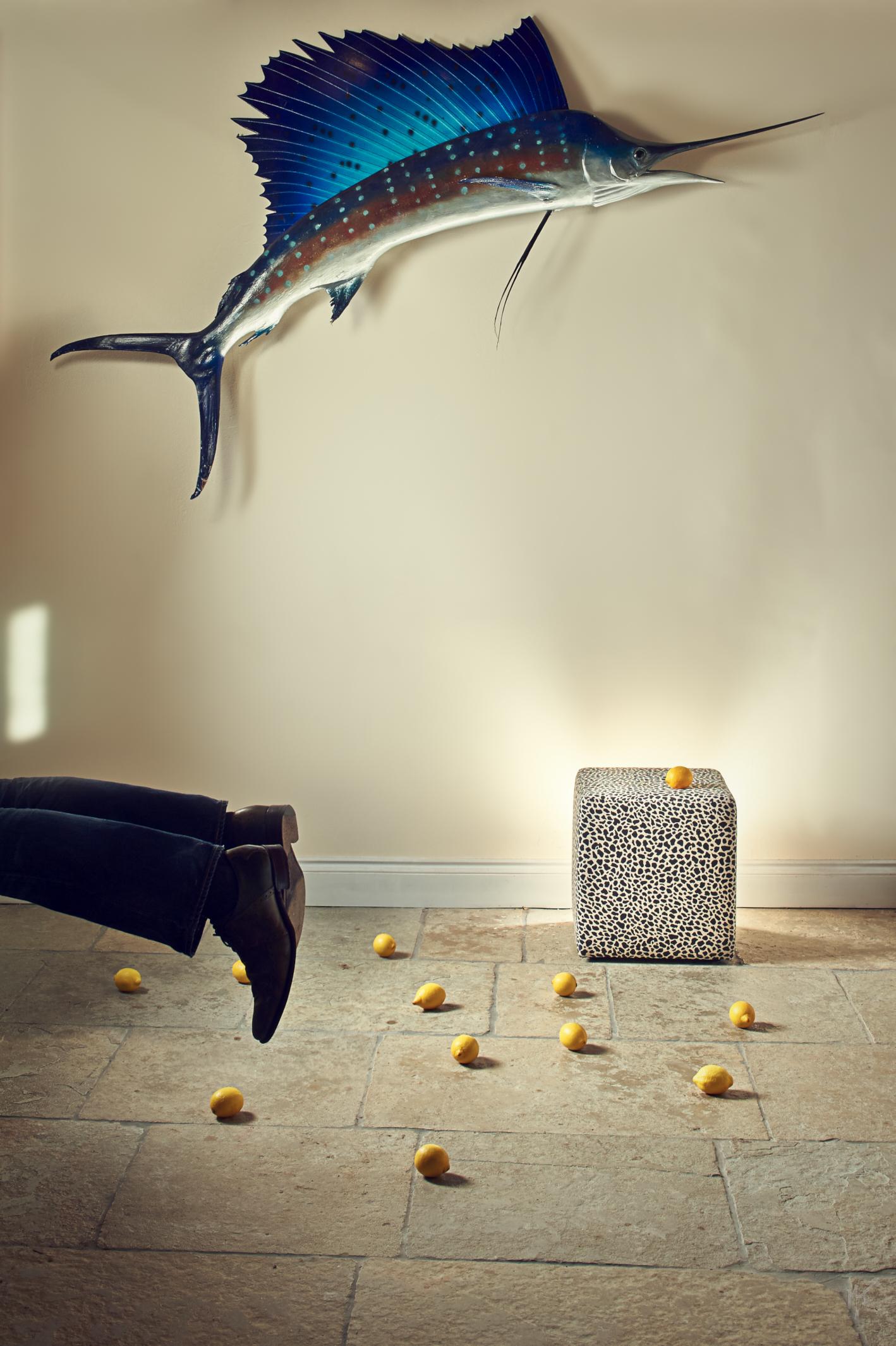 Photographer's portrait with sailfish and lemons