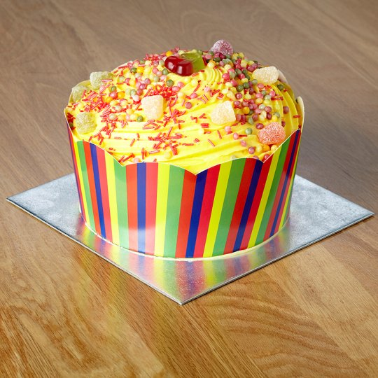 Tesco's Giant Cupcake  with a vibrant colour scheme for boys or girls, this sponge is filled with buttercream and raspberry jam.