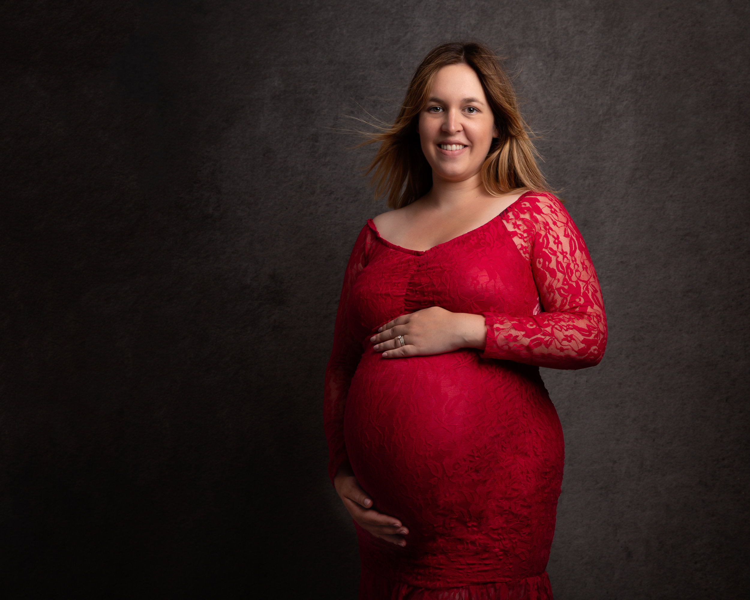 award-winning-maternity-portrait-red-dress-london-photographer.jpg