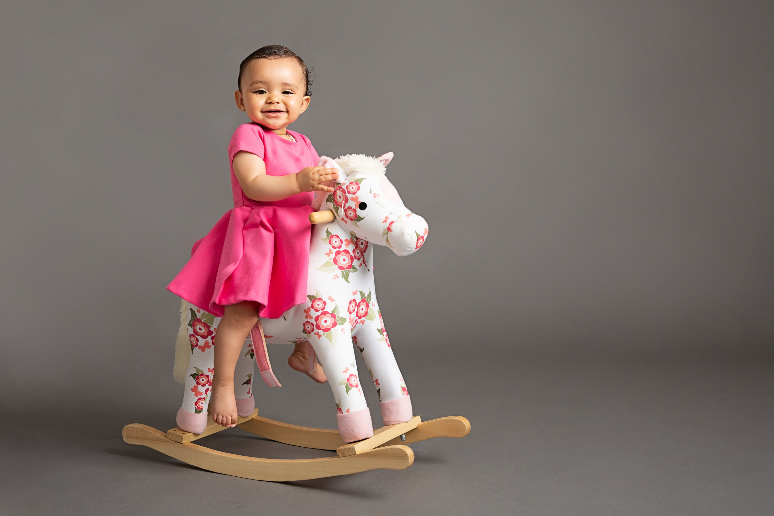 baby-girl-on-rockinghorse-photo-studio-london.jpg