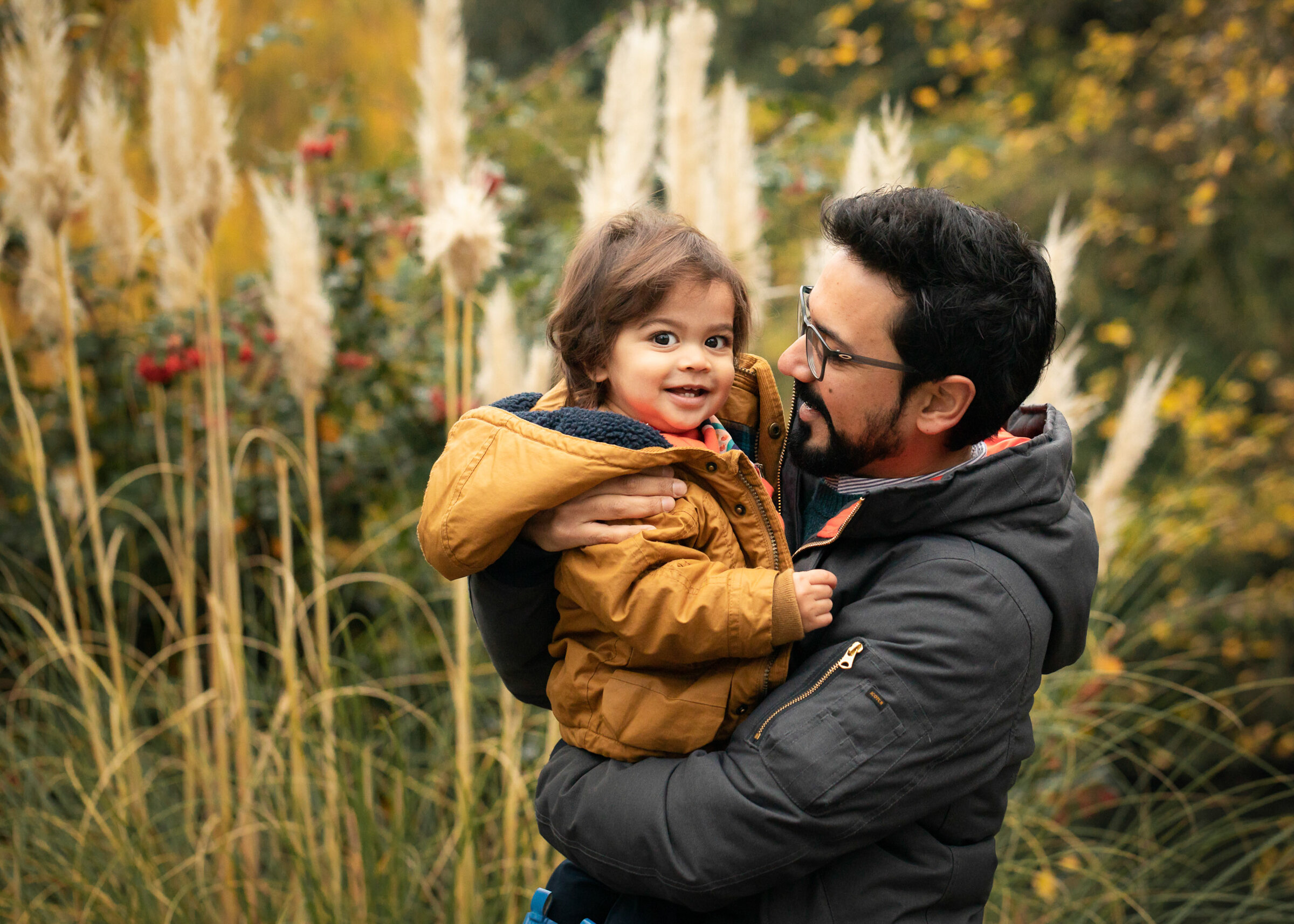 father and son in front pampas grass