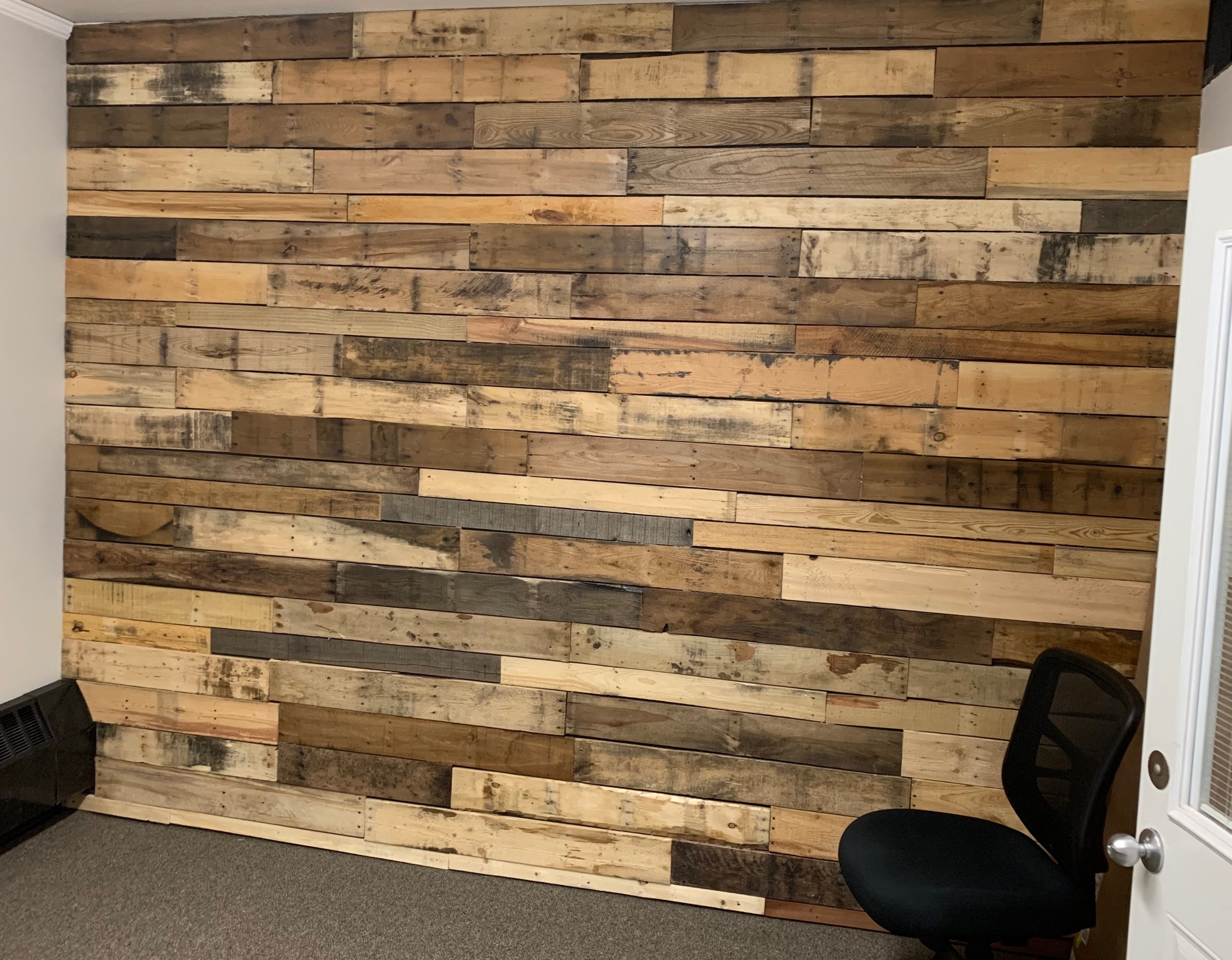 DIY: A Pallet Wall by a Pallet Pro | Gruber Pallets Inc