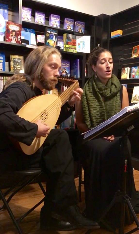Fiori Musicali  -             Krysta Ferrara - Soprano            Ryan Closs - Lute/Theorbo   Fiori Musicali - roughly translates to  Musical Flowers - is Long Island's own Lute Song duo.  They perform music and songs from 16th, 17th, and 18th centuries using historically informed approaches and instruments.   To the left is a moment from a bookstore performance where we paired a Lute solo with a stolen moment from Shakespeare that alluded to that very solo.  For extra flavor, we borrowed the very book off the store's shelf.      'If music be the food of love, play on'