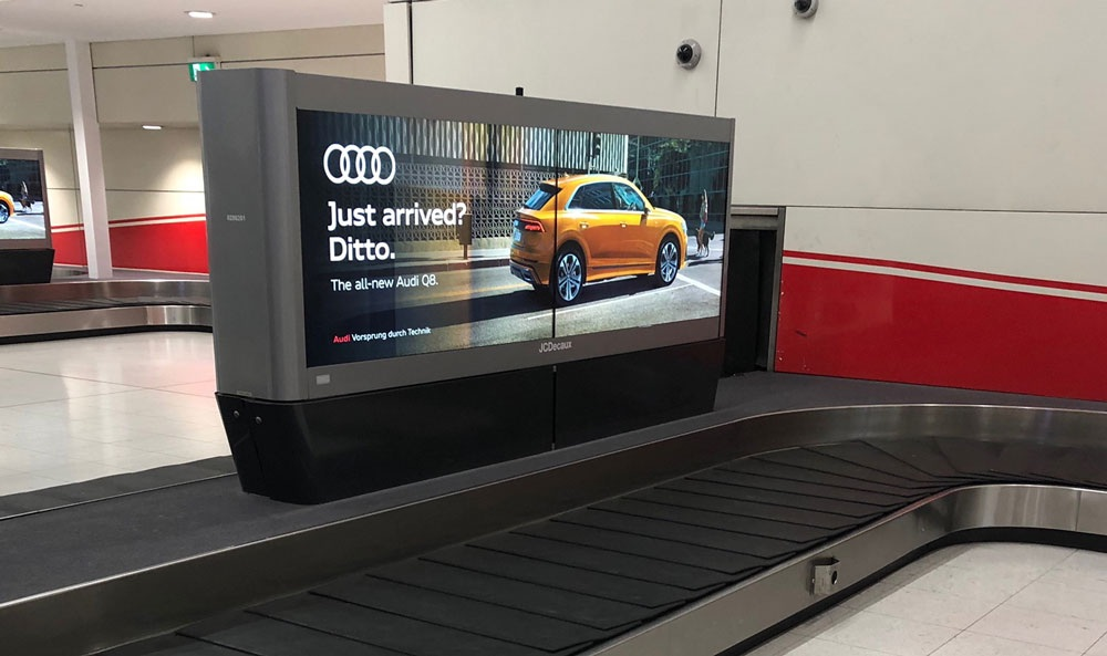 Airport baggage claim billboard