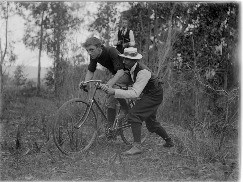 Shot by Mark James Daniel during the period when cycling in Australia was in a boom period. The rider and his handler mimicking a start in one of the greatest track races in the country, the Austral or one of the A.NA. wheel races.