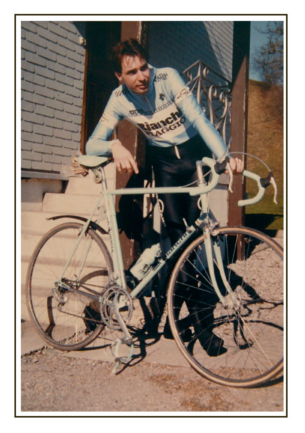 """Training in February 1987. Mudguards to scratch the new frame, and Zurich bicycle number plate attached by a plastic frame clip. The all polyester sublimated kit was mostly Descente including the full """"thermo suit"""" needed to ride in those temperatures. I had about five of these thermo suits and over the years they began to look like they'd """"melted"""" and had to be thrown away. The rest of our kit was Santini, all that good old wool stuff, even some old woolen dress shirts that looked like they came from Coppi's era. Photo by Willi Felix"""