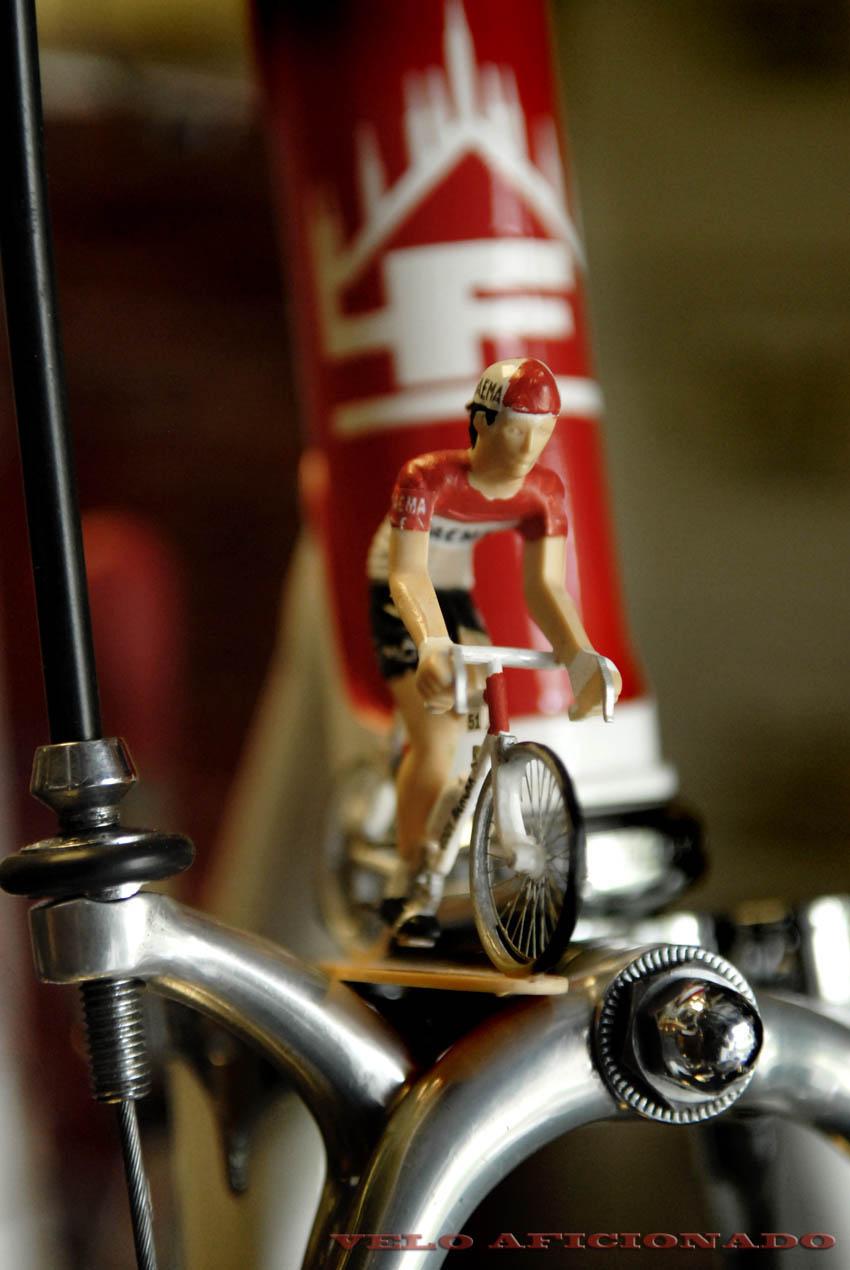 Eddy Merckx barreling along difficult uneven roads at Giro di Faema.