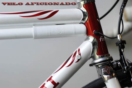 Polishes stainless steel on the Frezoni Faema 2013 evo bike