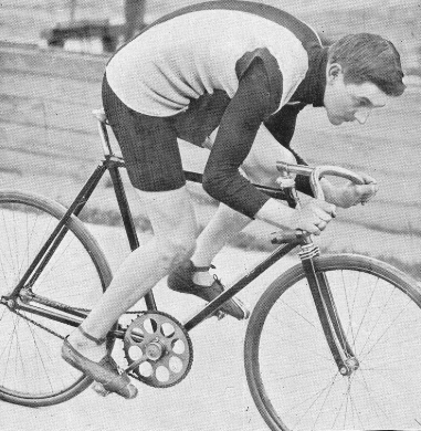Thaddäus Robl posing for the camera on a track bike with stock forks but way over the front in a stayer's position.