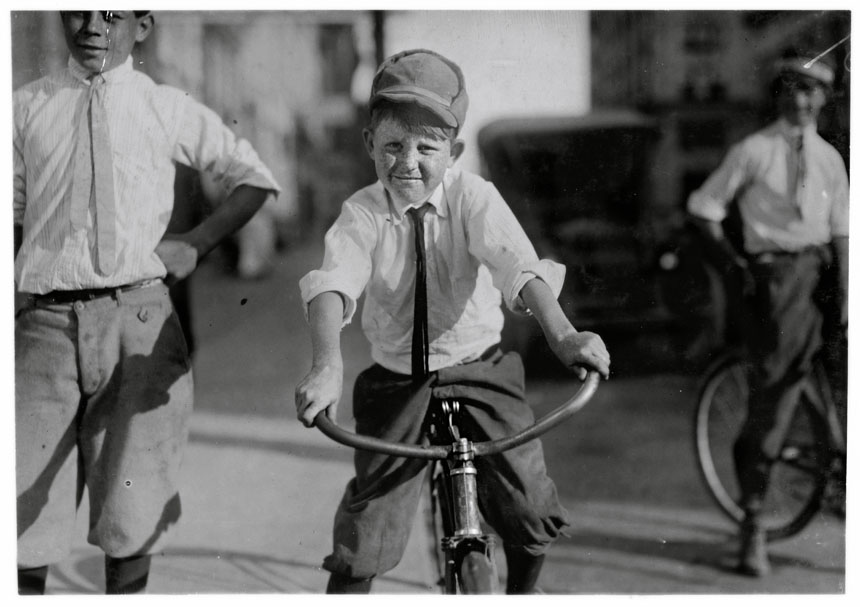 "Eleven year old Western Union messenger #51. J.T. Marshall Houston,Texas.      ""Been day boy here for five months. Goes to Red Light district some and knows some of the girls.""  October 1913"
