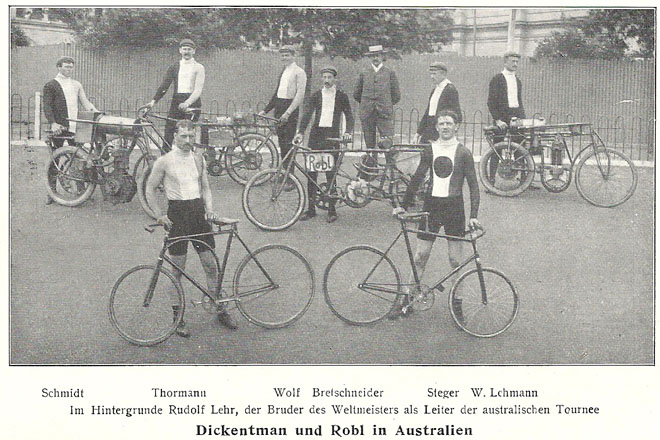 Thaddäus Robl (left) and Piet Dickentman (right) together with their motor pace team and a couple of their many motor pace machines. In the back is their manager Rudolf Lehr. Probably also shot by Albert Sutcliffe at the Exhibition Track where the famous Australian Natives Association races were held every January.