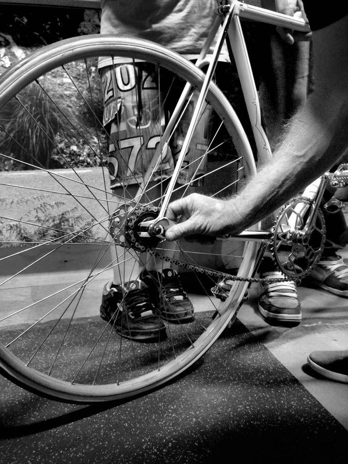 Tightening up the nuts with a shifter, wooahh, there was a 15mm Campag track spanner floating around somewhere.