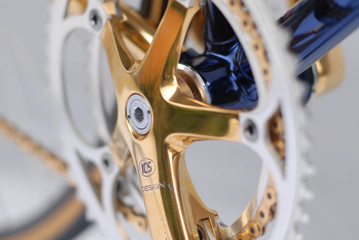 ICS design bottom bracket with dark blue paint over gold plating, showing the re-formatted ICS crank design for C Record Campagnolo.