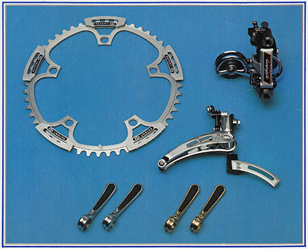 The ICS drivetrain components, re-worked Campagnolo Super Record. Anatomic gear shift levers with rubber inserts, front derailleur with chain catcher, 3-D system diagonally adjustable rear derailleur and 53T big pizza with chain guides.