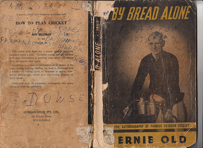 """One of Arthur's warnings to other cyclists, """"Stolen from"""". A very well read copy of Ernie Old's book By Bread Alone."""
