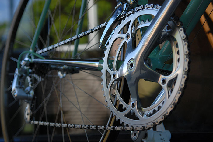 At the beginning of 1987 Campagnolo released the 2nd gen crankset with the printed shield logo. This Corsa Record crankset has the highly sought after stamped Campagnolo shield logo.  53 t x 42 t