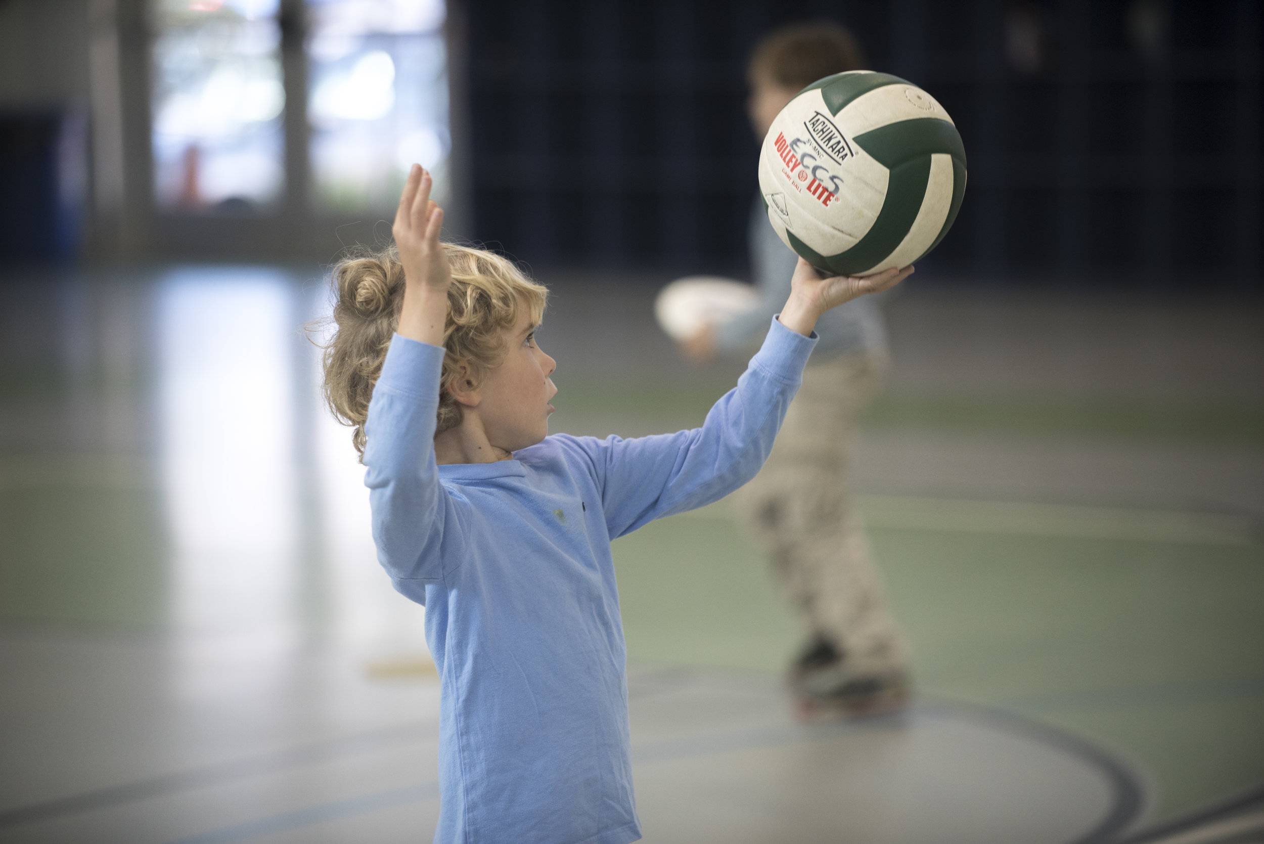 Landon uses correct form of striking a volleyball.