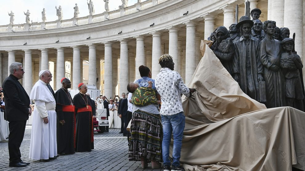 Pope Francis, left, watches the unveiling of a new sculpture on the occasion of the World Day of Migrants and Refugees, in St. Peter's Square, at the Vatican, on Sept. 29, 2019. (Vincenzo Pinto/Pool Photo via AP)
