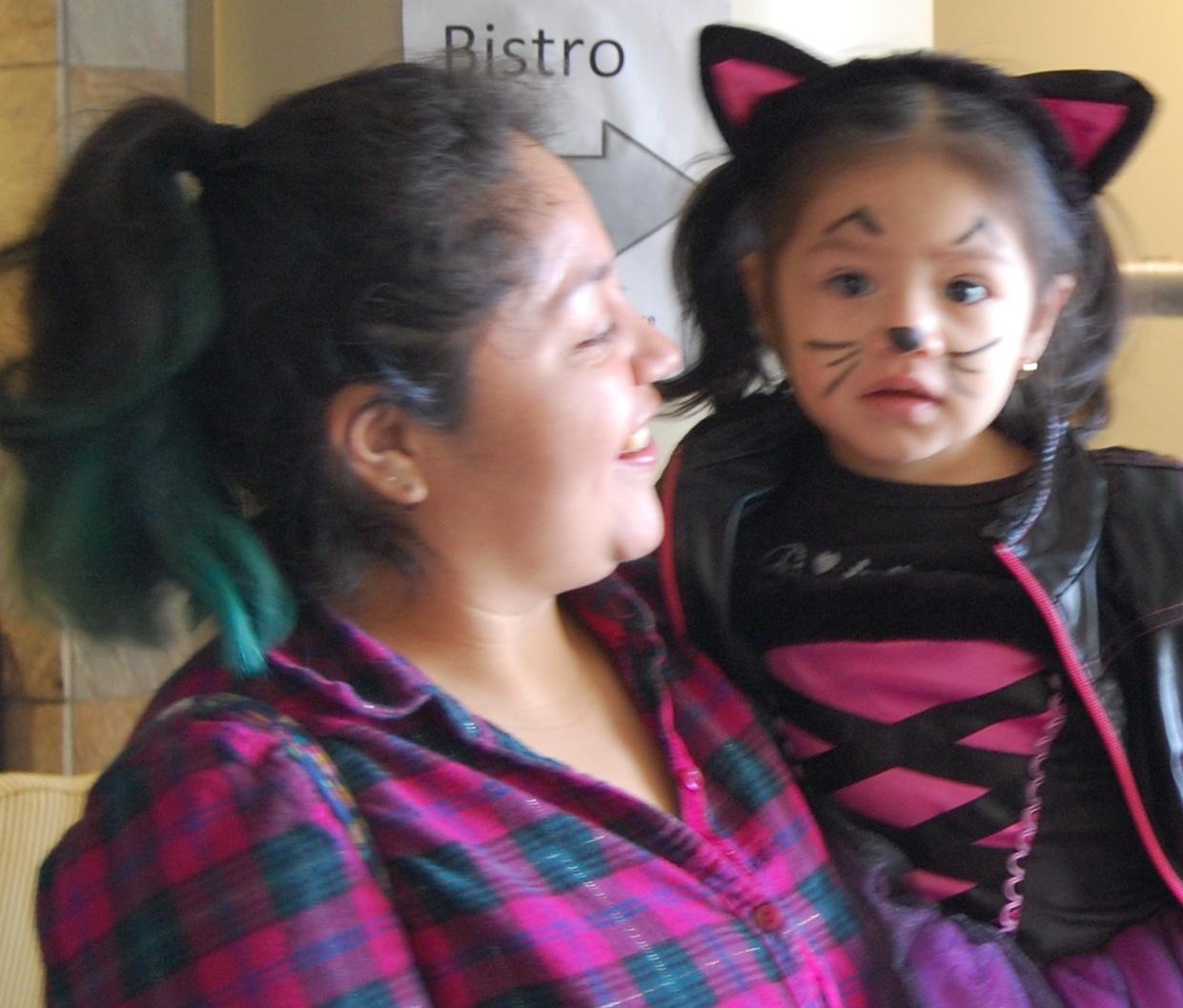 Pre-schooler in Hallowe'en costume and caregiver