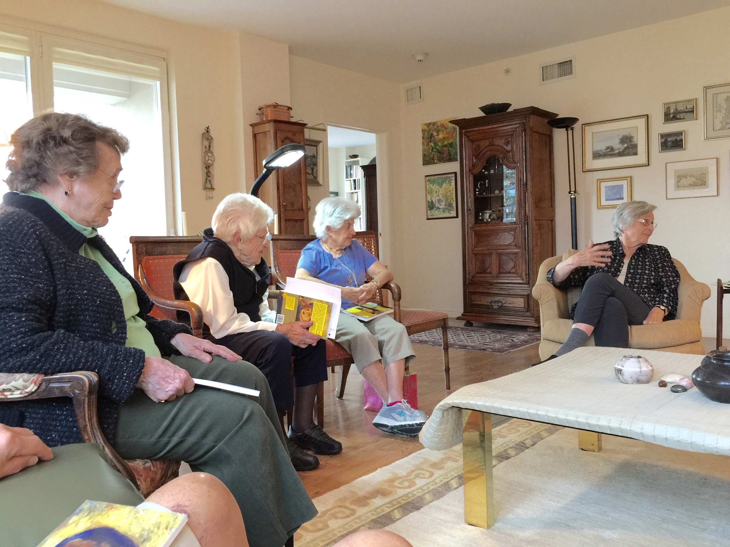 French Conversation group meeting in the home of a native-born French-speaking KOH resident